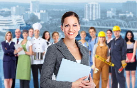 Professional-woman-and-group-industrial-workers_Fotolia_43972915_M